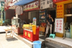9256522-cheap-street-food-in-chongqing-china-small-family-restaurant--july-28-2010.jpg