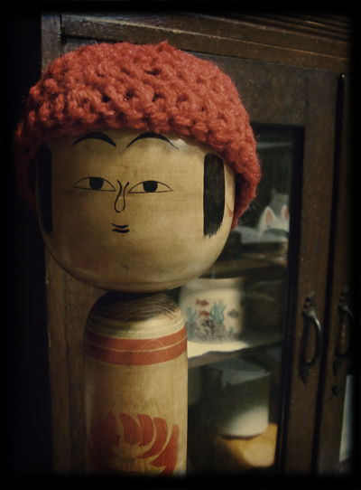 帽子をかぶった丑蔵