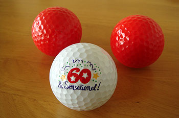 還暦お祝いに! 真っ赤なゴルフボール