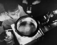 750px-Physicist_Studying_Alpha_Rays_GPN-2000-000381.jpg
