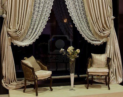6435863-luxurious-old-fashioned-chairs-vase-with-yellow-roses-and-designer-window-curtains.jpg