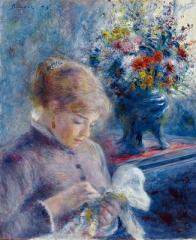 縫い物をする若い女