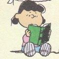 読書するルーシー Charles M. Schulz