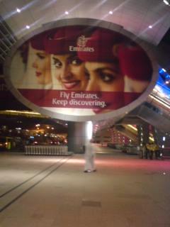 emirates sign at terminal 3 of dubai airport