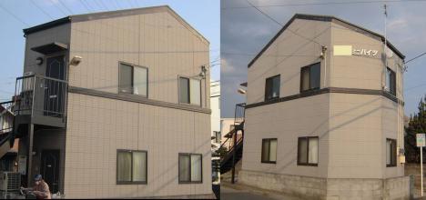 変形したコーポ住宅二階建二世帯分のデジカメ写真