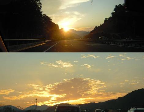 中央高速道路から富士五胡道路にて夕日が沈んでいく瞬間のデジカメ写真