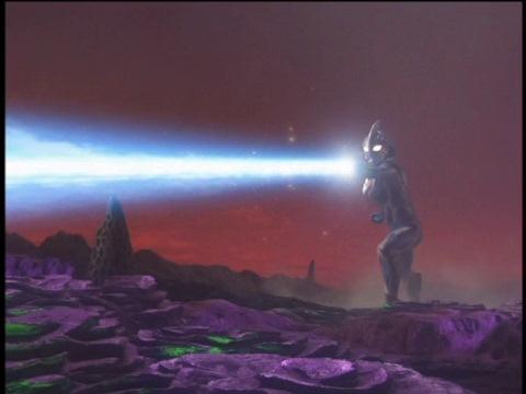 ナックレイジェネレードを放ち、バグバズングローラーを殲滅するウルトラマンネクサス(ジュネッスブルー)
